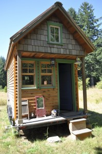 Photo of a tiny house. Is less more or less or does it depend?