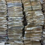 Photo of stacks of archived patient files