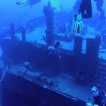 Looking at the bow of a sunken ship from above and behind.