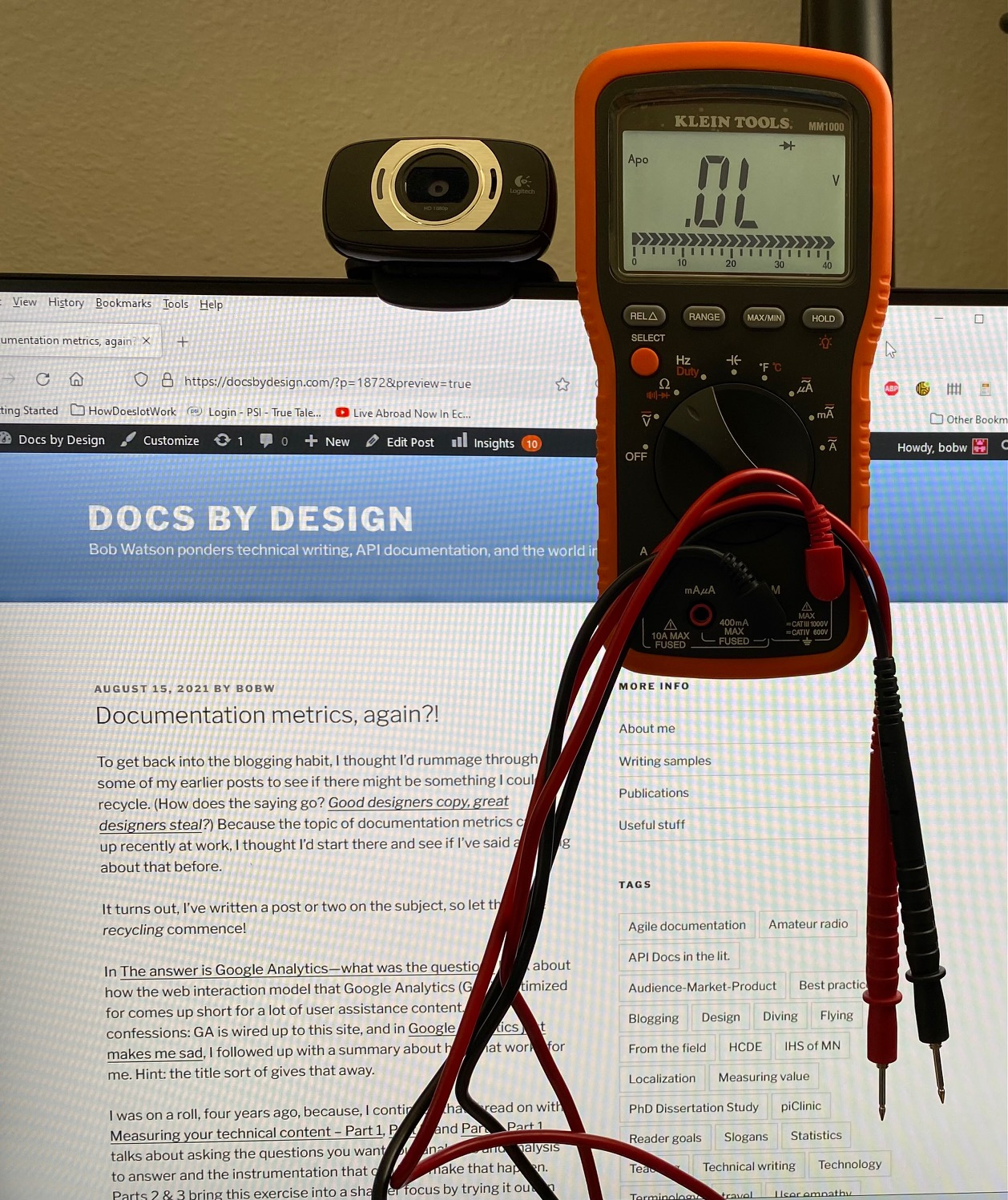 A digital voltmeter being prepared to measure a web page.